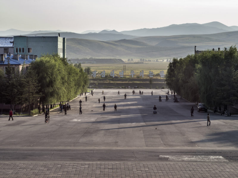 Carl De Keyzer - Hoeryong, North Hamgyong Province. View from the central square. Located on the border with China, Hoeryong has been an important garrison town and trading center since the 15th century. 21 September 2015 4:00 PM