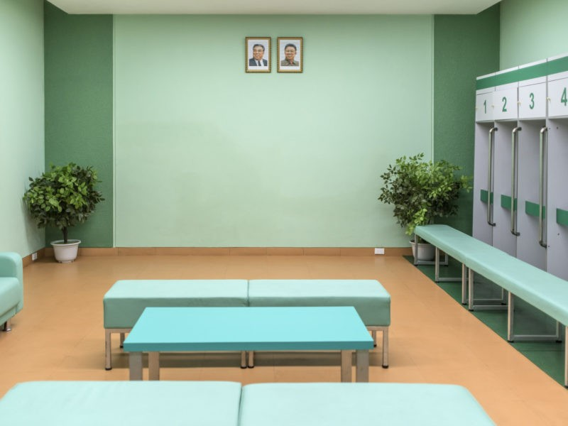 Carl De Keyzer - Locker room in the May Day Stadium, Pyongyang. Portraits of the DPRK leadership hang on the wall, just as they do in classrooms, offices and living rooms. 8 October 2015 11:00 AM