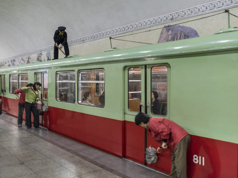 Carl De Keyzer - Metro staff wipe down a car, Pyongyang. The metro is closed for two days a month for fullscale maintenance. 9 October 2015 4:00 PM