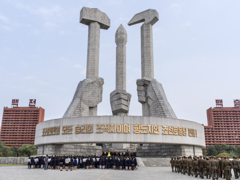 Carl De Keyzer - Monument to Party Foundation. Pyongyang. The symbol of the Korean Workers' Party adds a writing brush, for the intelligentsia, to the traditional hammer and sickle of other communist parties. 8 October 2015 2:00 PM