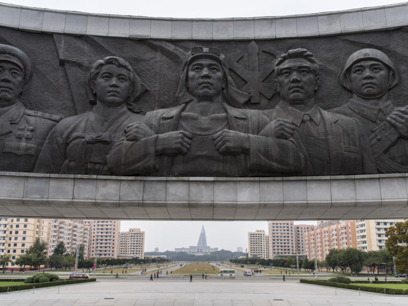 Carl De Keyzer - Monument to Party Foundation. Pyongyang. Bronze relief depicting workers, farmers, and intellectuals, flanked by the soldiers. The symbol of the Korean Workers' Party adds a writing brush, signifying the intelligentsia, to the traditional hammer and sickle of other communist parties. 8 October 2015 1:00 PM