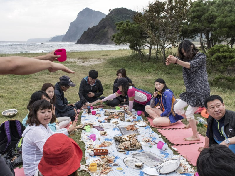 Carl De Keyzer - Mt. Chilbo, North Hamgyong Province. Ethnic Koreans from China enjoy a beachside picnic of fresh seafood. Many of China's roughly two million citizens of Korean descent have family ties just across the border. Large populations of ethnic Koreans also live abroad in Japan and the United States. 19 September 2015 5:00 PM