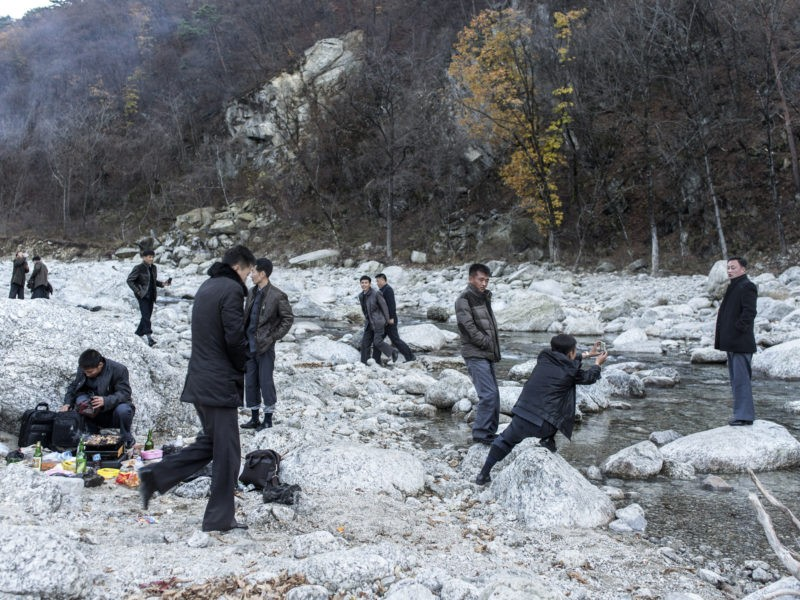 Carl De Keyzer - Mt. Myohyang, South Pyong'an Province. Preparing for a barbecue in a river bed. When traveling domestically and abroad, it is common for Koreans to travel with their work units, although travel with family and friends is now becoming more common. 31 October 2015 3:00 PM