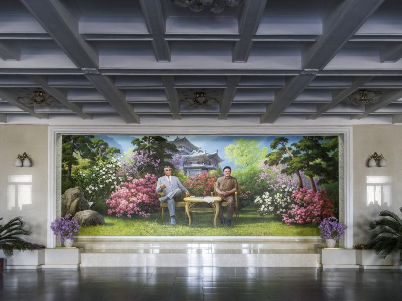 Carl De Keyzer - Mural depicting President Kim Il Sung and General Kim Jong Il in front of the International Friendship Exhibition; Chongchon Hotel, Mt. Myohyang, South Pyong'an Province. 31 October 2015 1:00 PM