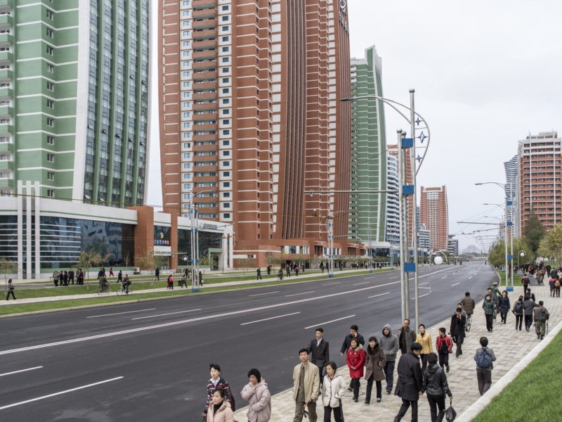 Carl De Keyzer - Pedestrians on Future Scientists Street, Pyongyang. This new residential district opened in 2015, and is reserved for scientists, academics, professors, and their families. 8 November 2015 4:00 PM