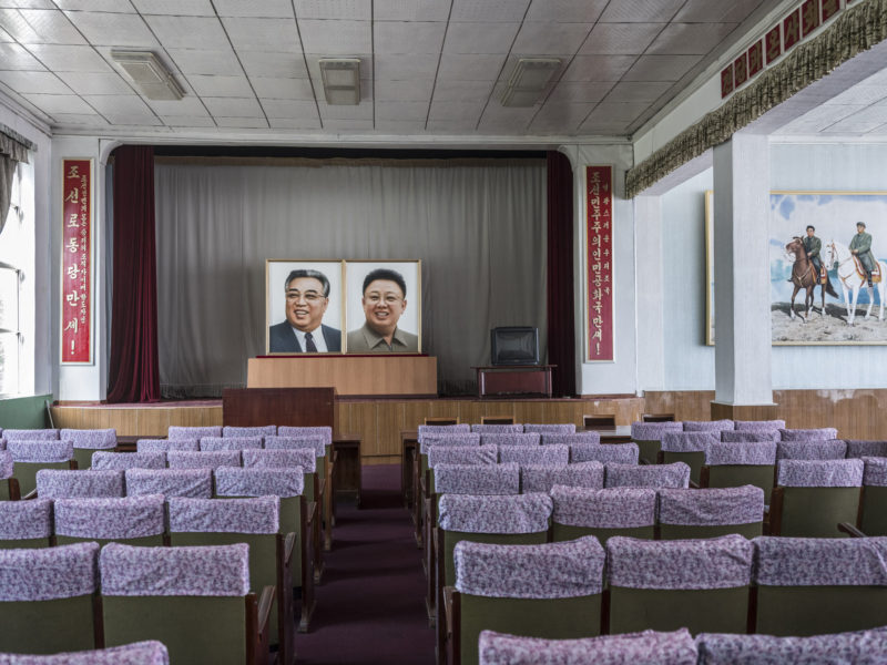 Carl De Keyzer - Seamen's club, Nampo. Small theater used for performances and political meetings. The slogans on the sides say Long Live the Workers' Party of Korea and Long Live the Democratic People's Republic of Korea. 5 June 2017 5:00 PM