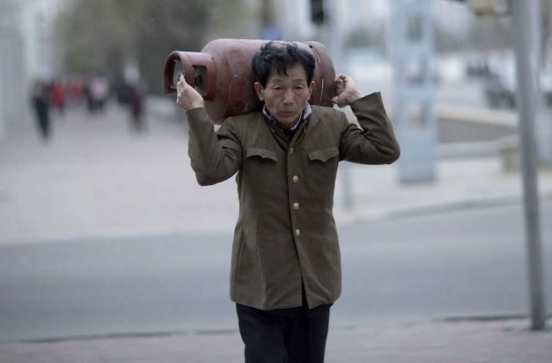 Eric Lafforgue – North Korea - It is forbidden to take pictures of the daily life of the North Korean people if they are not well dressed. For my guide this man was not well dressed enough to be photographed