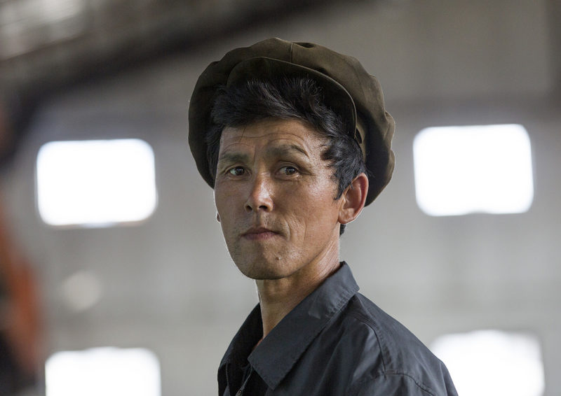 Eric Lafforgue – North Korea - A worker at the Hungnam Fertilizer Complex in Hamhung. While it is officially said that the site produces fertilizers, the facility has also been used for the manufacture of chemical weapons