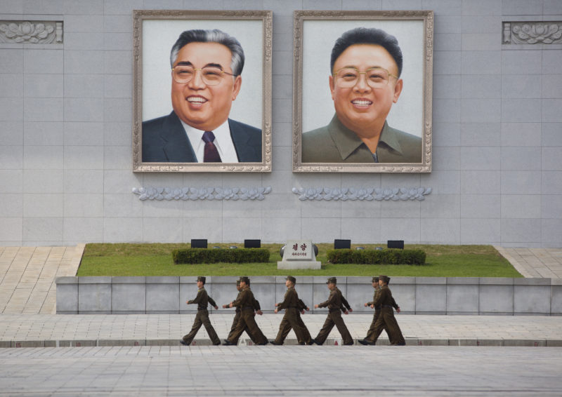 Eric Lafforgue – North Korea - North Korean army soldiers pass in front of the giant portraits of Kim Jong-il and Kim Il-Sung at Kim Il-sung Square in Pyongyang