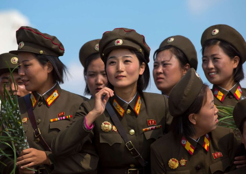 Eric Lafforgue – North Korea - Smiling North Korean female soldiers in Tower of the Juche Idea, Pyongyang​