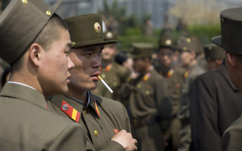 Eric Lafforgue – North Korea - Soldiers are supposed to get a perfect attitude in public areas. But on a sunday, those ones were much more relaxed