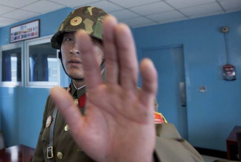 Eric Lafforgue – North Korea - Taking pictures in the DMZ is easy, but if you come too close to the soldiers, they stop you