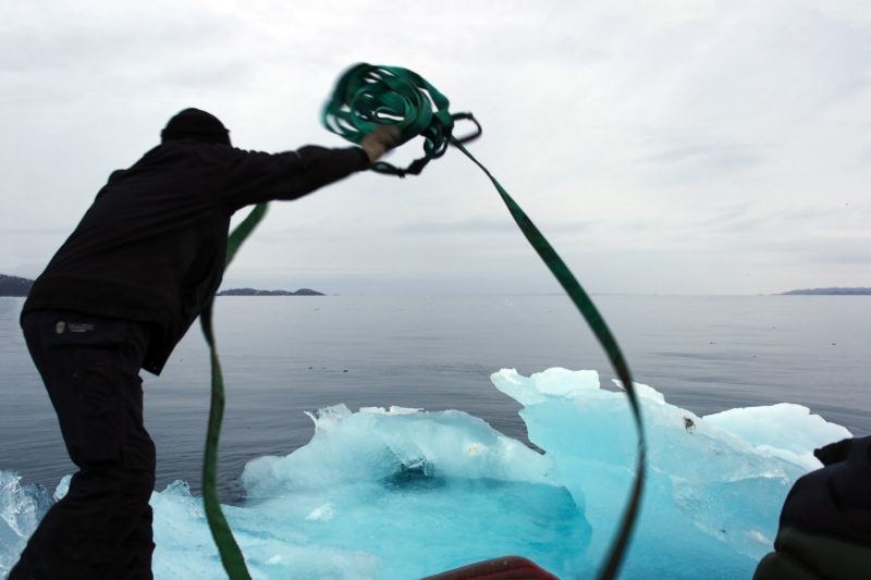 Harvesting ice through Nuup Kangerlua, Greenland, for Ice Watch in Copenhagen, 2014
