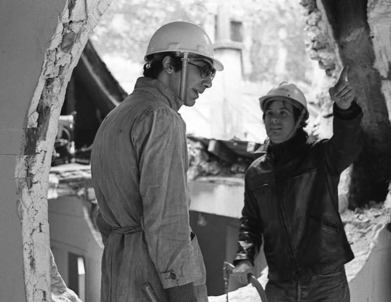 Gordon Matta-Clark and Gerry Hovagimyan working on Conical Intersect, 1975