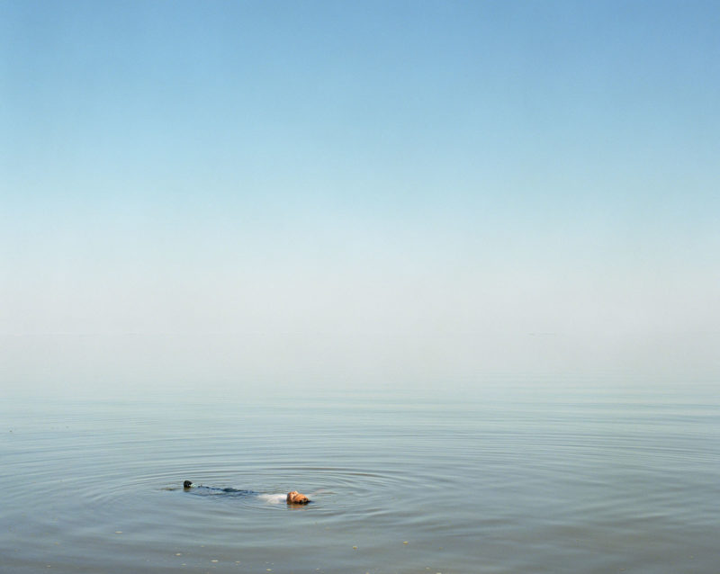 Ron Jude - Lago - Boy Floating in Water, 2012